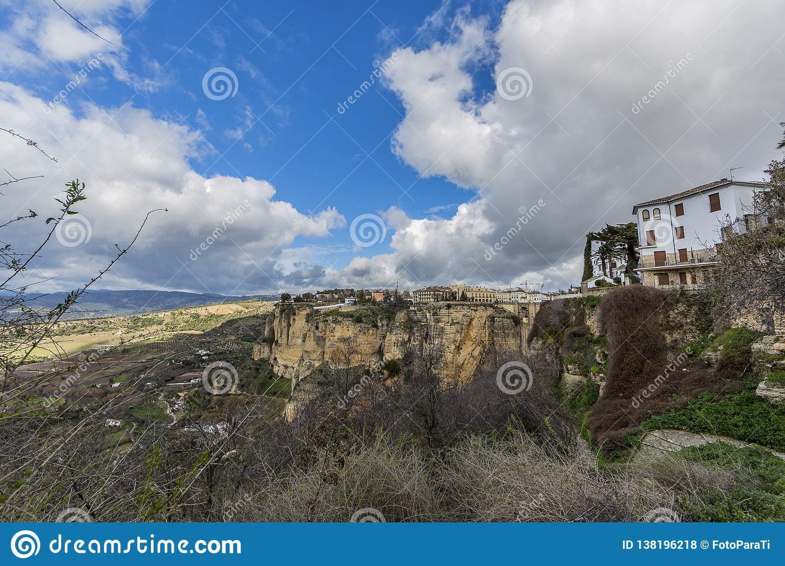 Beautiful panoramic view of the city of Ronda over the mountain with its valley with farmland