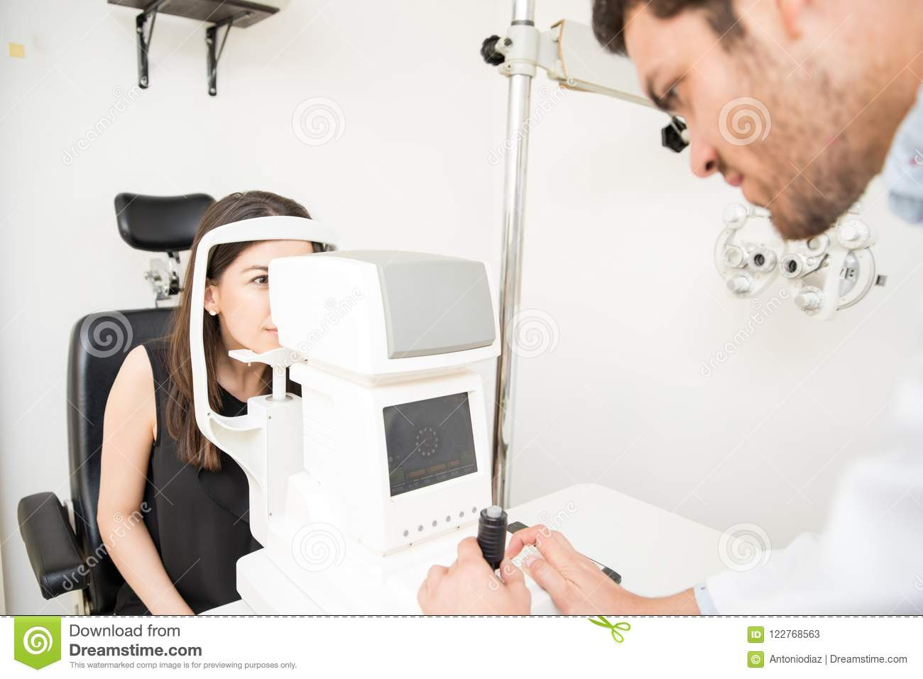 Attractive Woman Getting Eye Test Done By Handsome