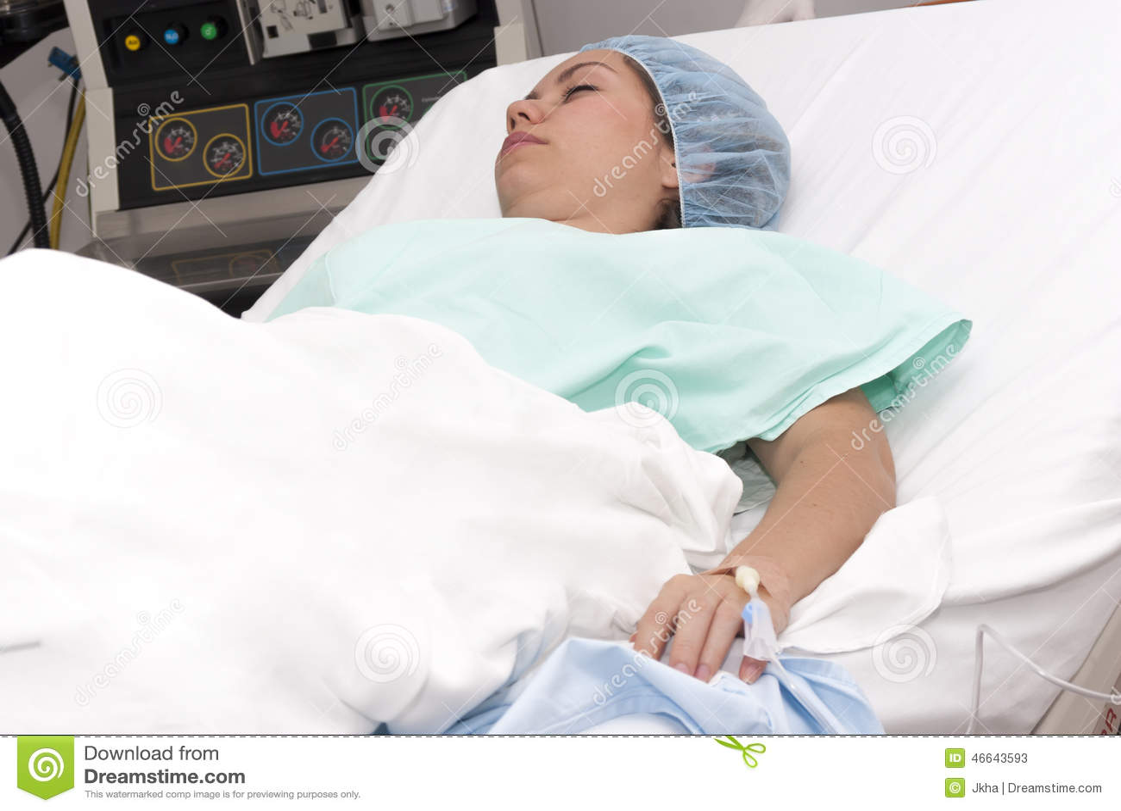 Black Woman Lying In Hospital Bed