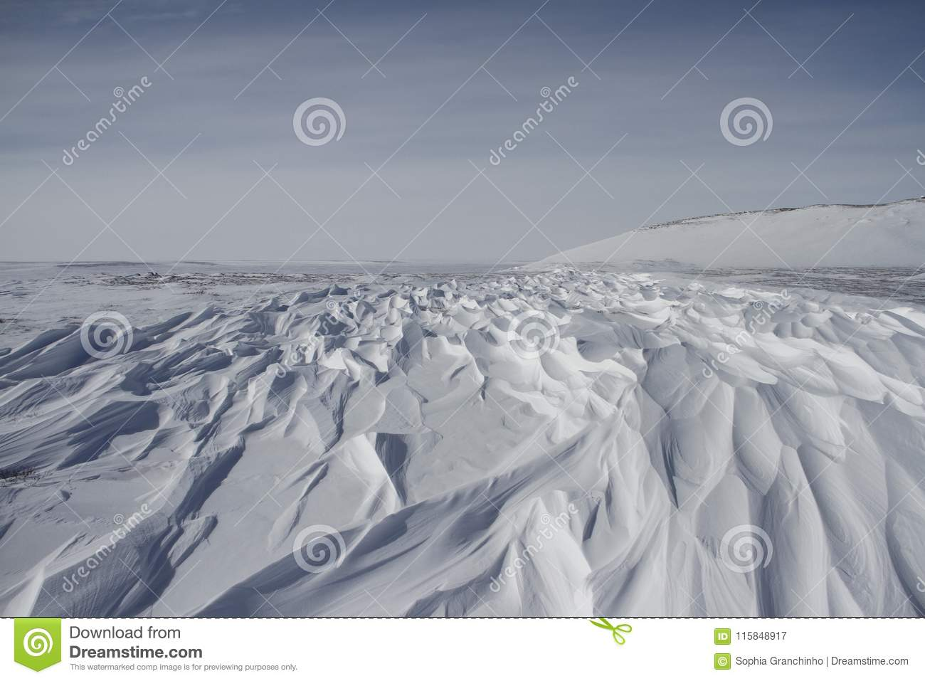 Beautiful patterns of sastrugi, parallel wavelike ridges caused by winds on surface of hard snow
