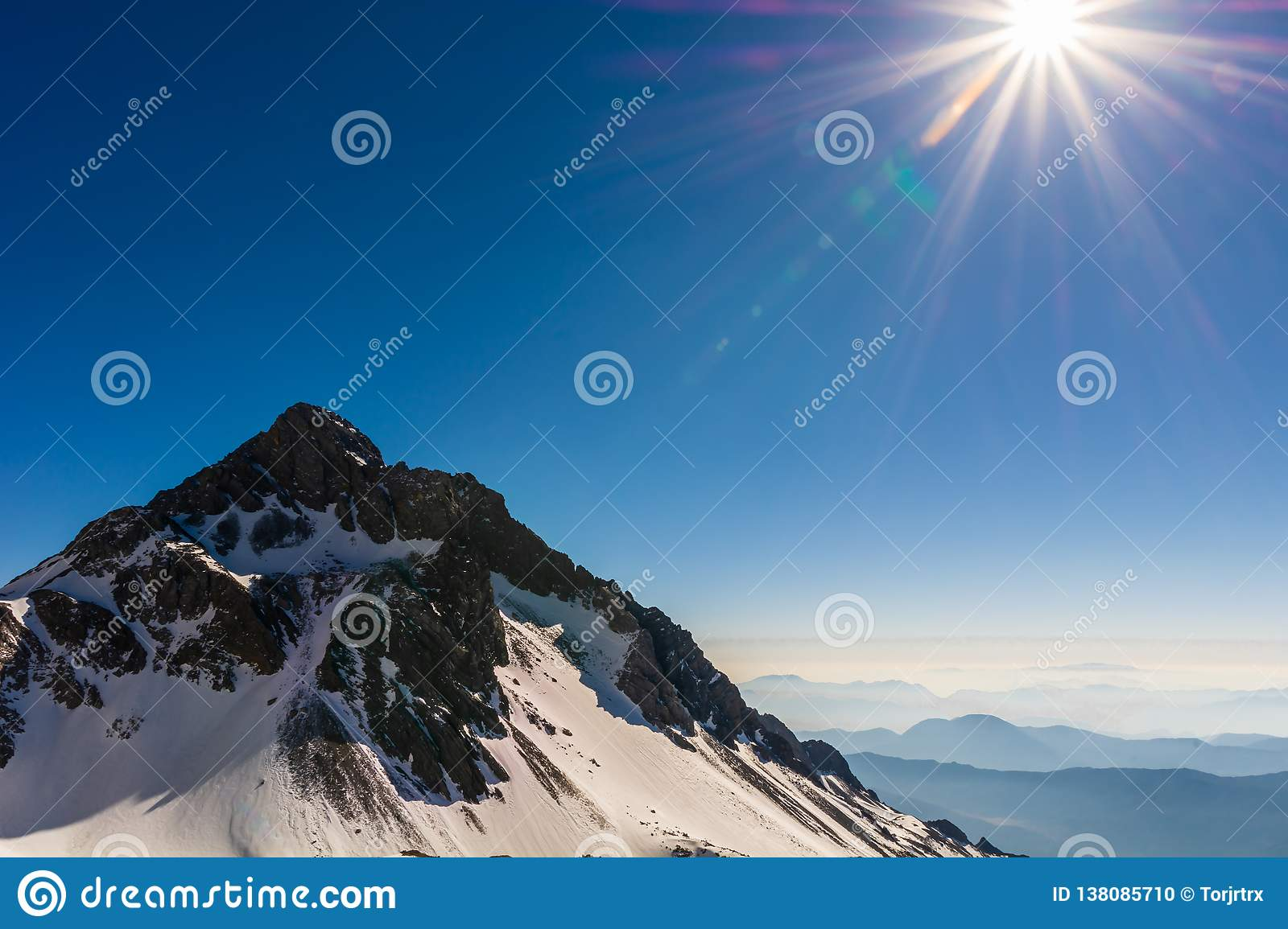 Beautiful and peaceful scenery of snow mountain peak in morning sunlight veiw from Jade Dragon Snow mountain`s viewpoint, Lijiang