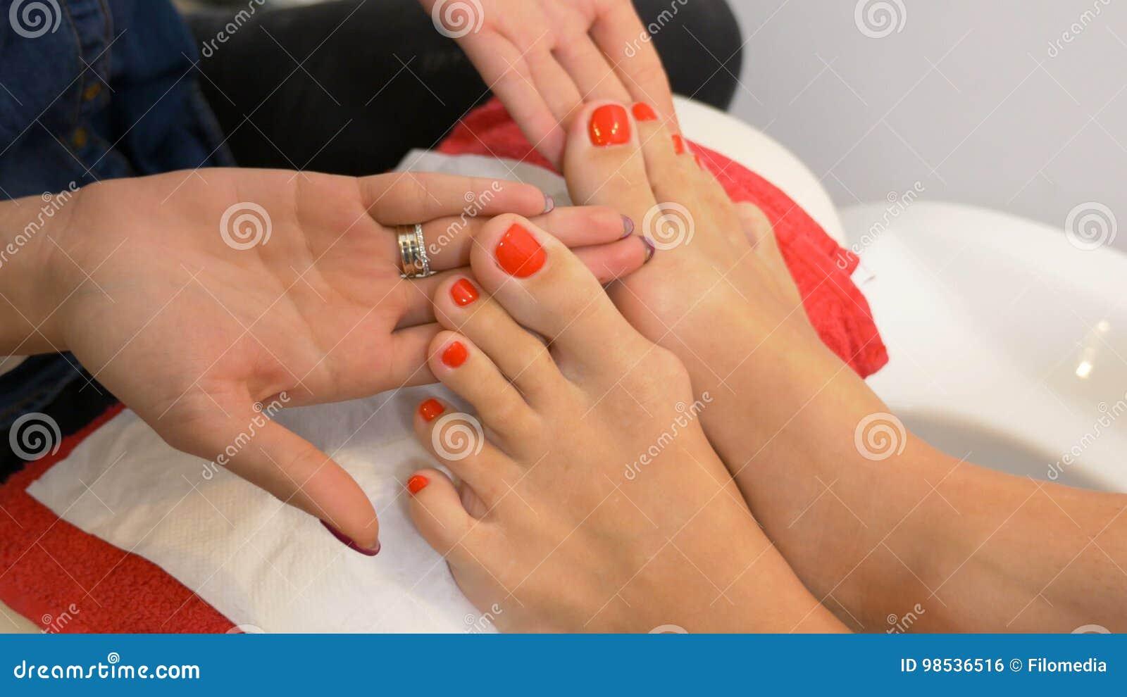 Beautiful Pedicure With Red Nail Polish Presented At Nail Art ...