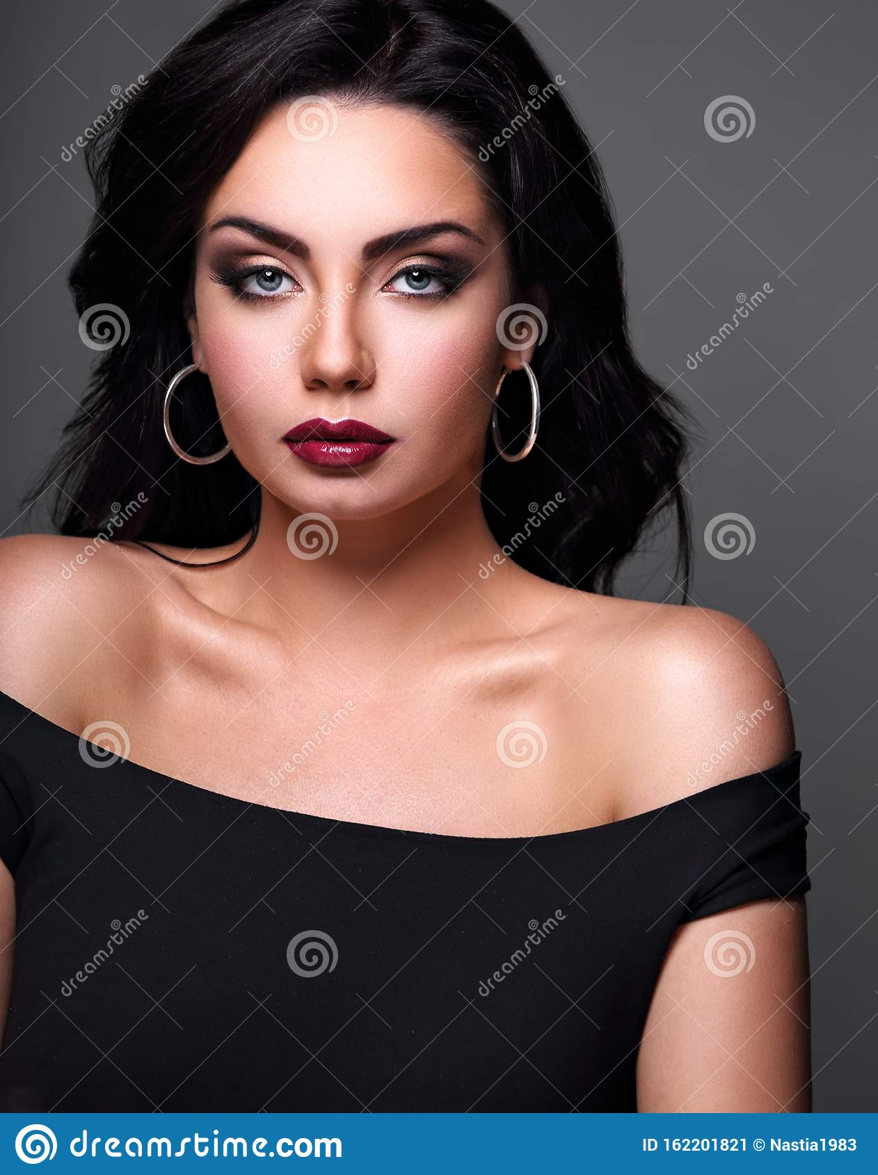 beautiful perfect makeup blue eyes woman with long black