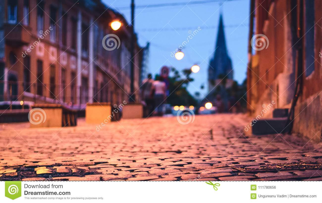 Beautiful photo of sibiu street with selective focus and evangelical church in background at twilight