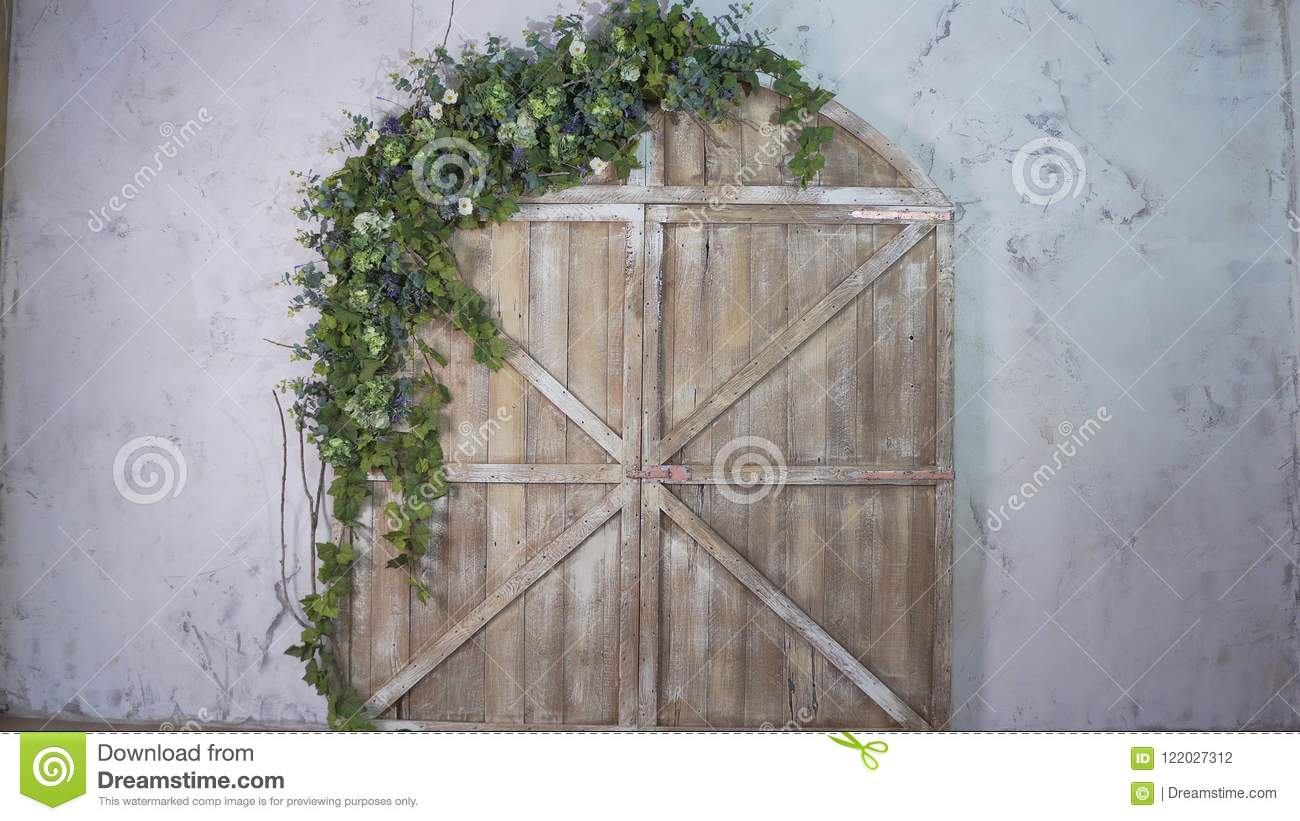 Beautiful Photo Zone Wooden Gate And Arch Of Flowers Stock Photo