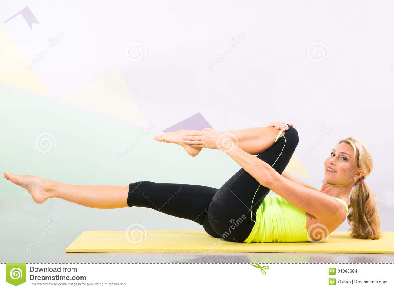 Beautiful Pilates Instructor With Yellow Yoga Mat Stock Images - Image: 31380384