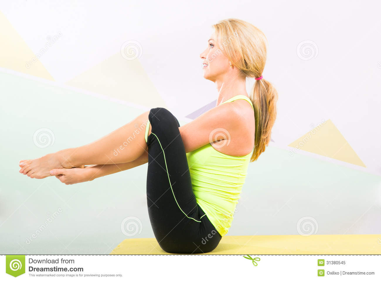 Beautiful Pilates Instructor With Yellow Yoga Mat Stock