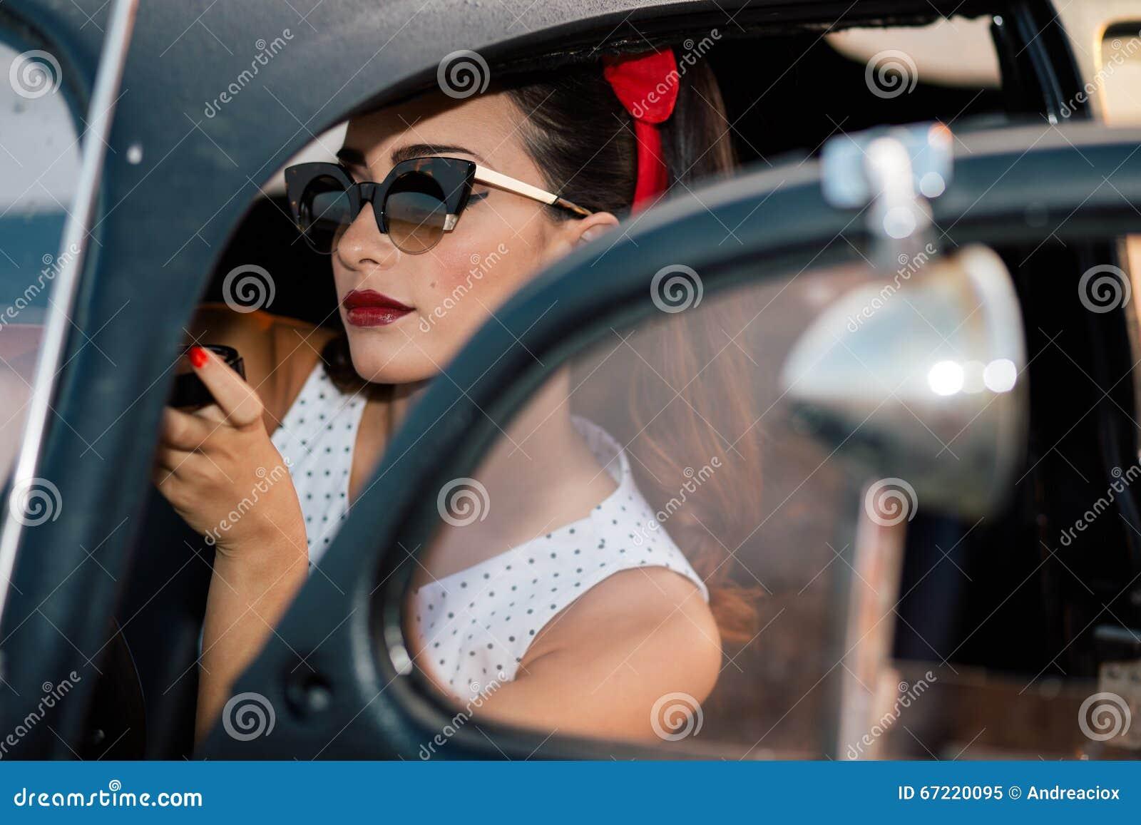 Beautiful Pin-up Girl Inside Vintage Car Putting Makeup ...