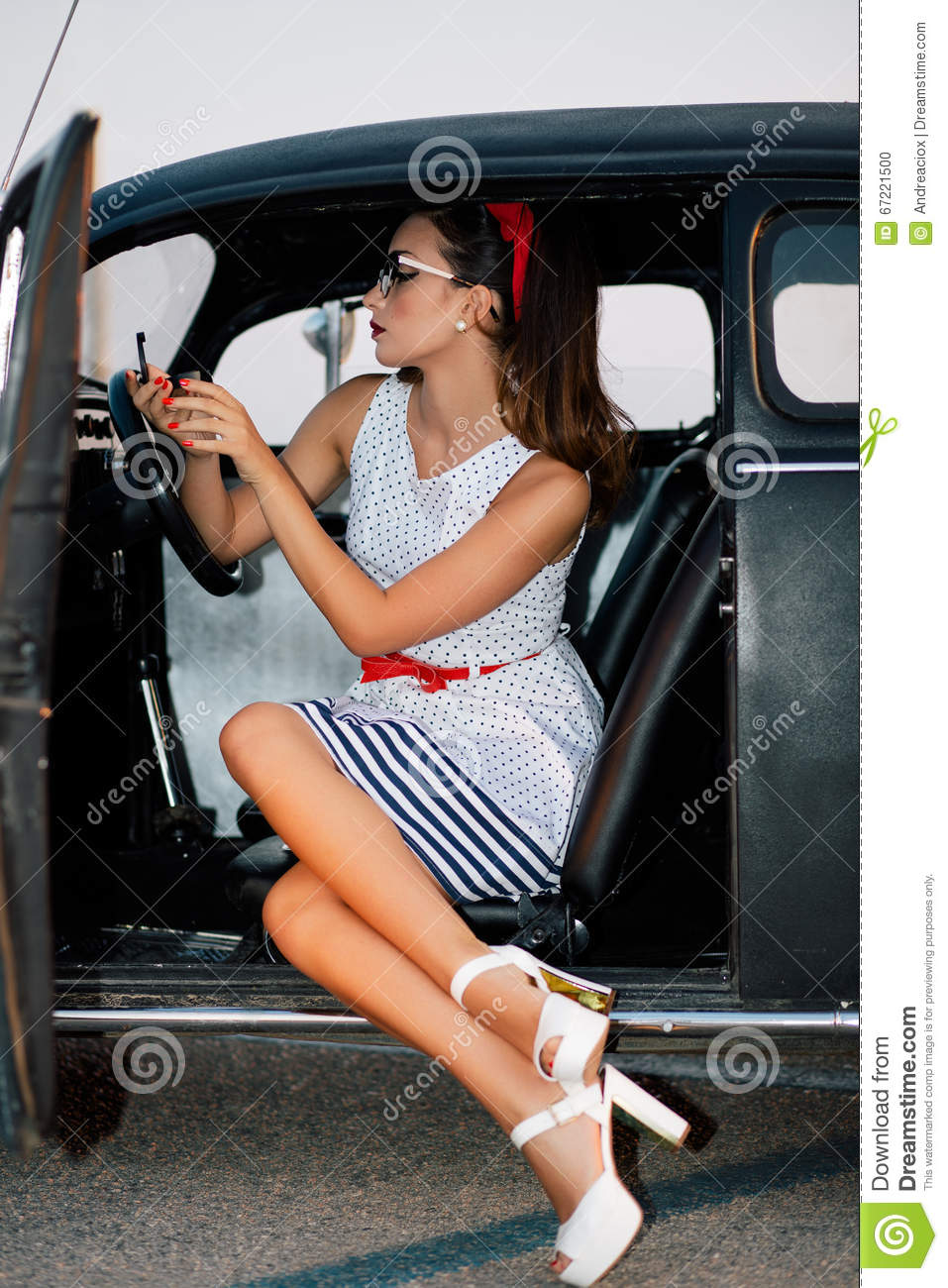Beautiful Pin-up Girl Inside Vintage Car Watching Mirror ...