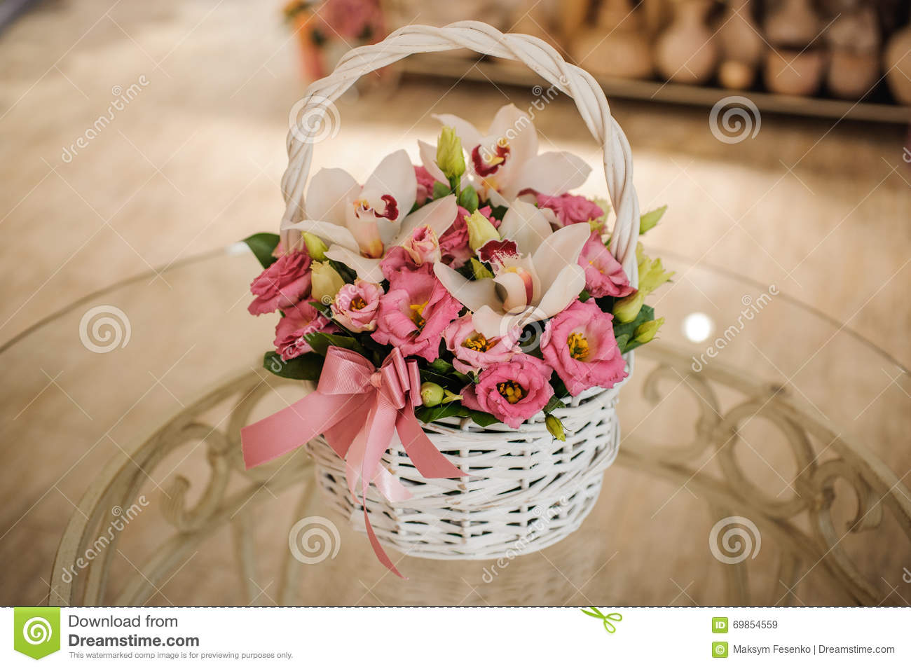 Beautiful Pink Bouquet Of Mixed Flowers In Basket On Table Stock