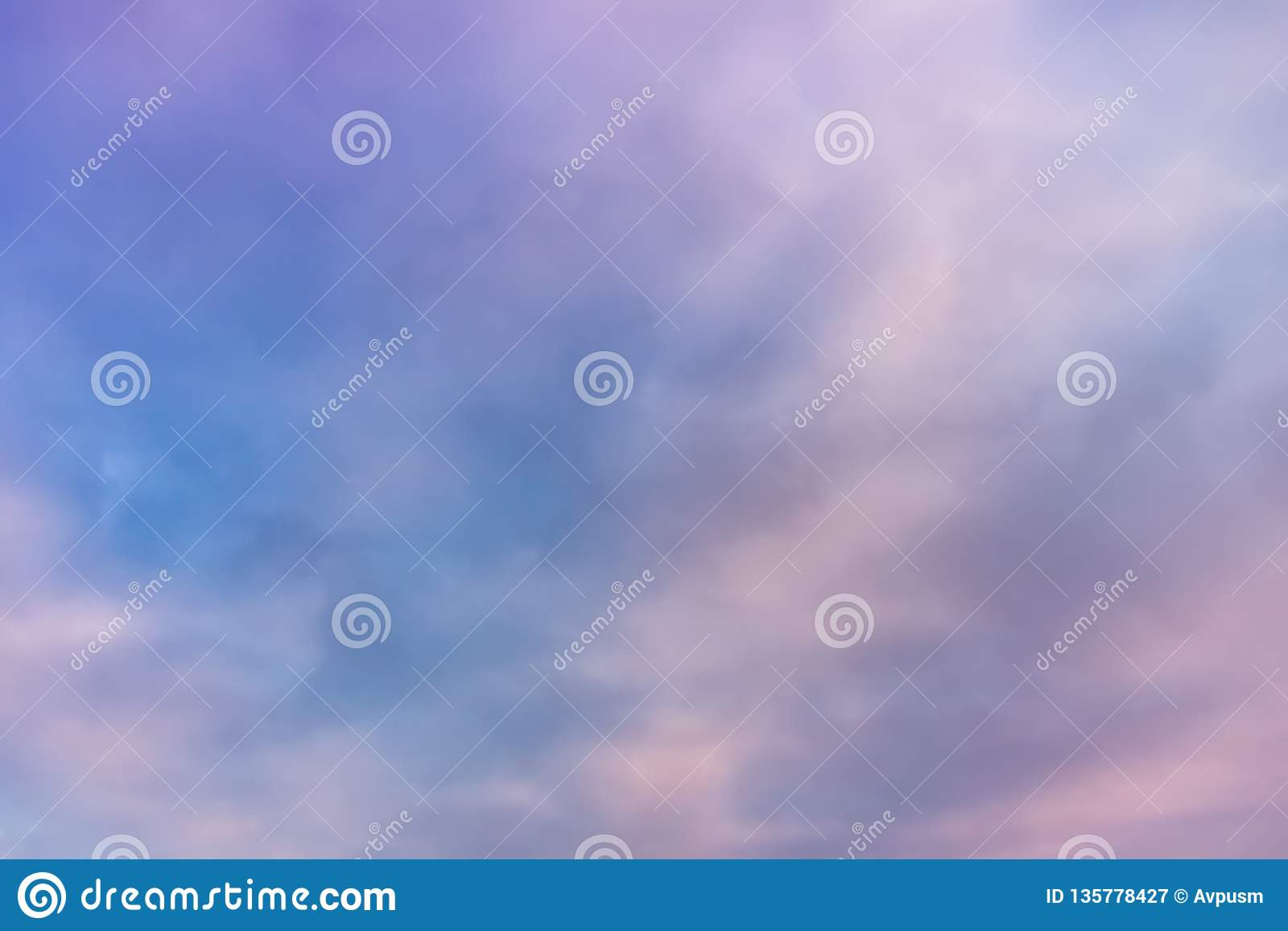 Beautiful pink clouds on the blue sky. Pastel of sky and soft cloud abstract background