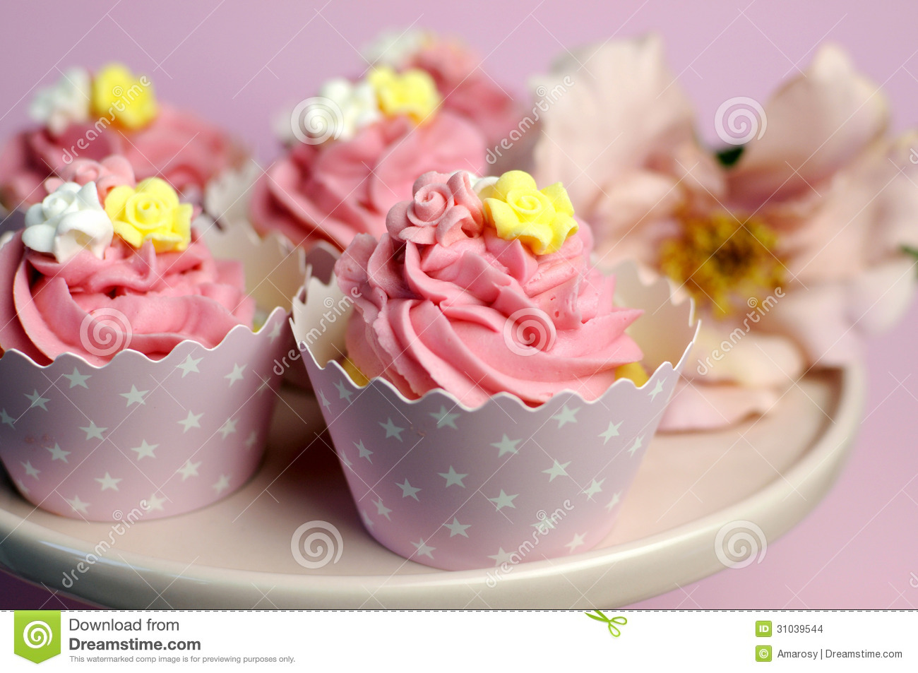 Beautiful Pink Decorated Cupcakes On Pink Cake Stand