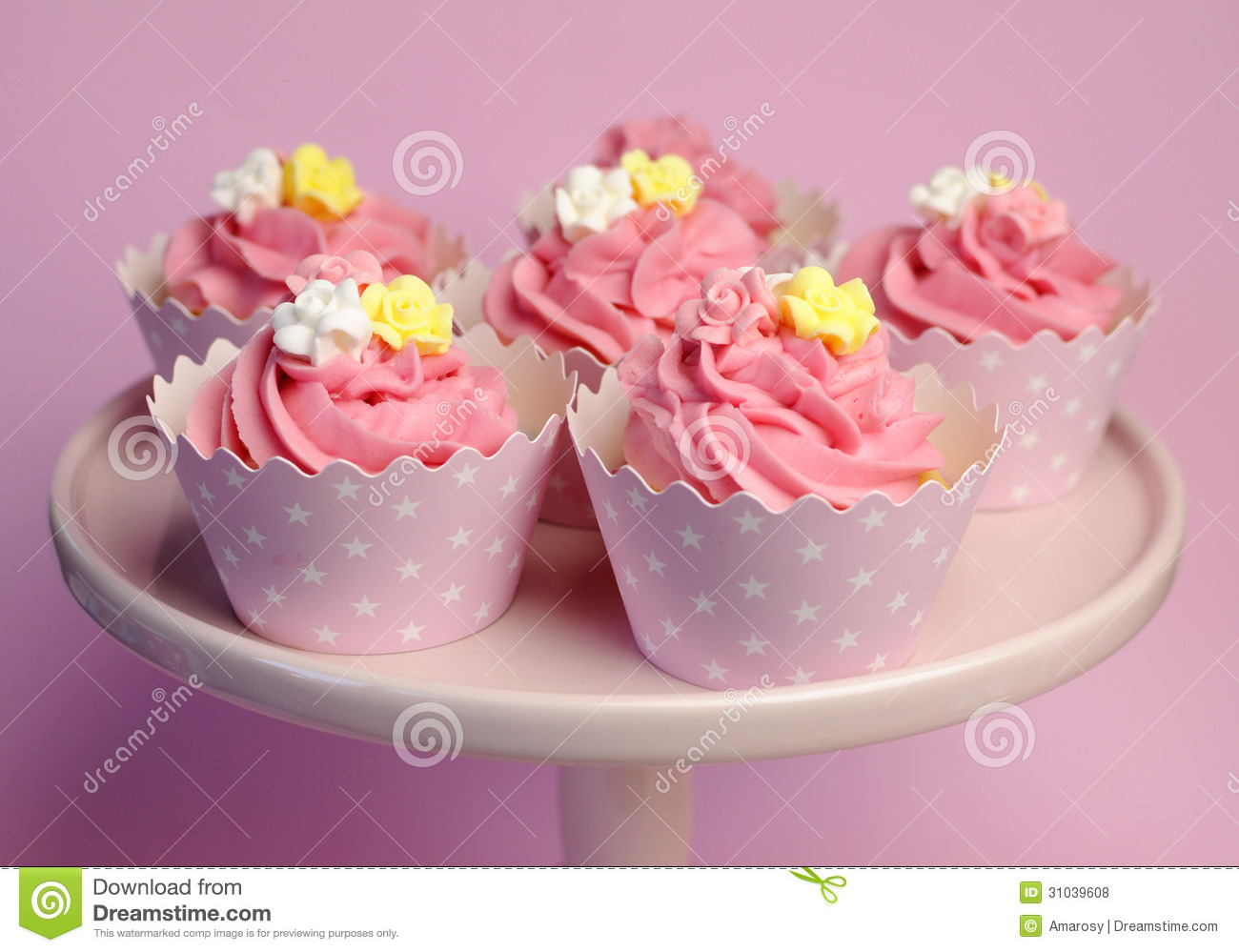 Beautiful Pink Decorated Cupcakes On Pink Cake Stand In
