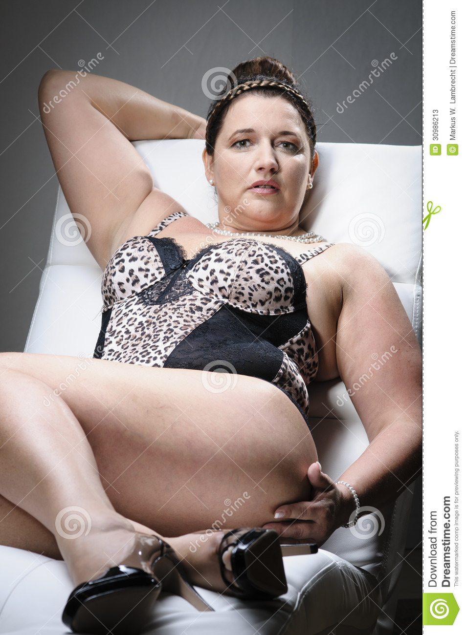 c9455ea67e6 Beautiful plus size woman stock image. Image of interior - 30986213