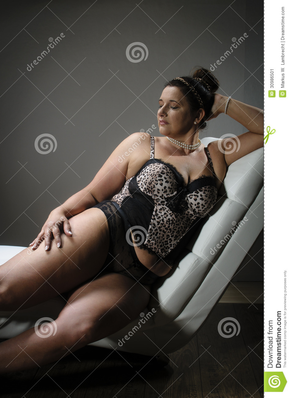 d43ed92b7c7 Beautiful Plus Size Woman On White Armchair Stock Image - Image of ...