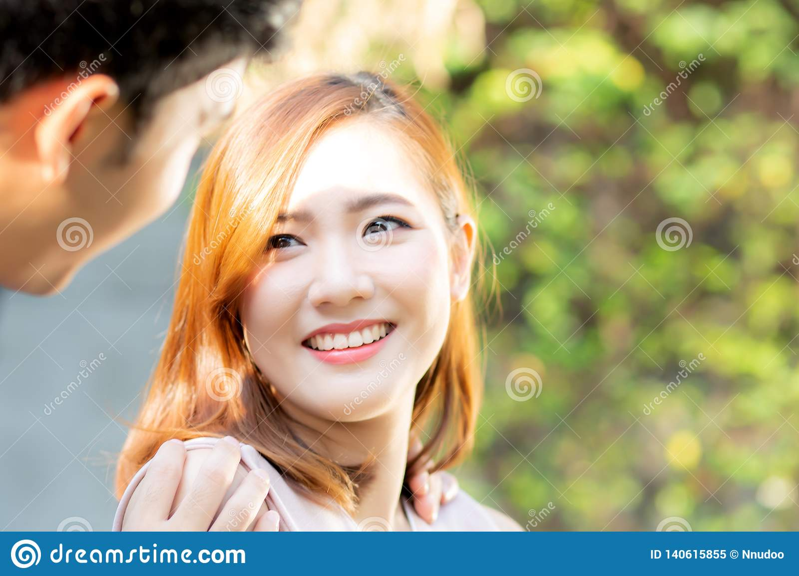Beautiful portrait couple looking each others eyes and smiling with happy, young asian man and woman relation with love dating