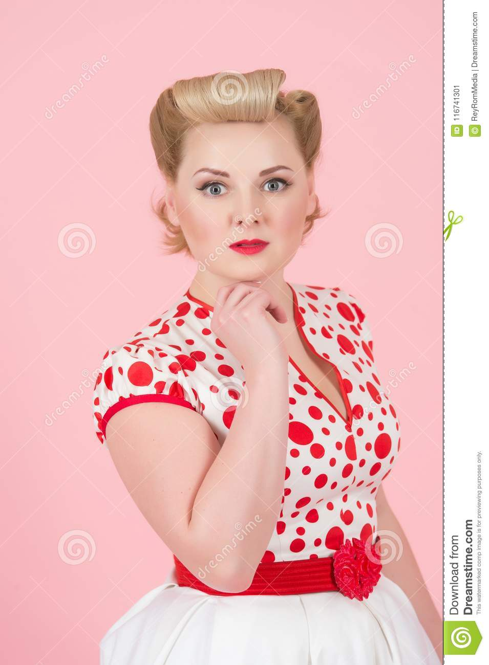 Beautiful portrait of vintage styled female model with glamour pin-up makeup and hair dress.