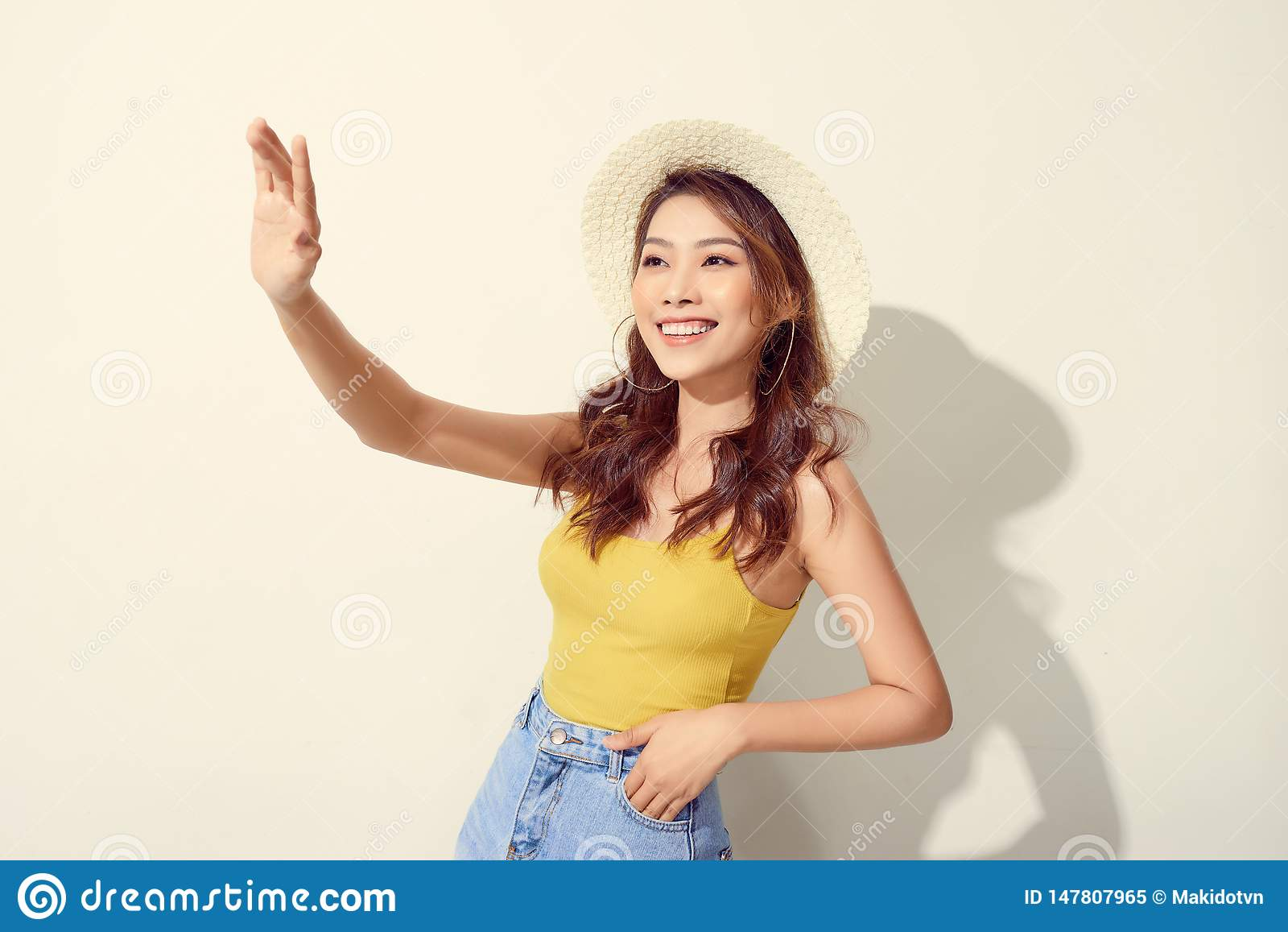 Beautiful portrait young asian woman wear round hat smile excited and confident enjoy summer holiday isolated white background