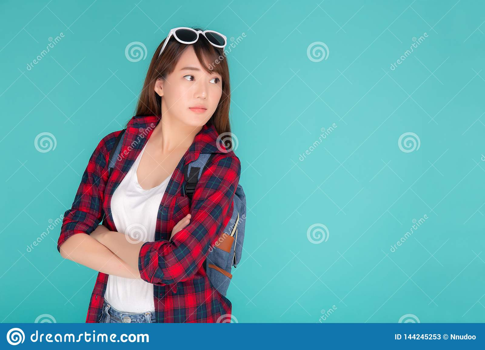 Beautiful portrait young asian woman wear sunglasses on head smile expression confident enjoy summer holiday isolated