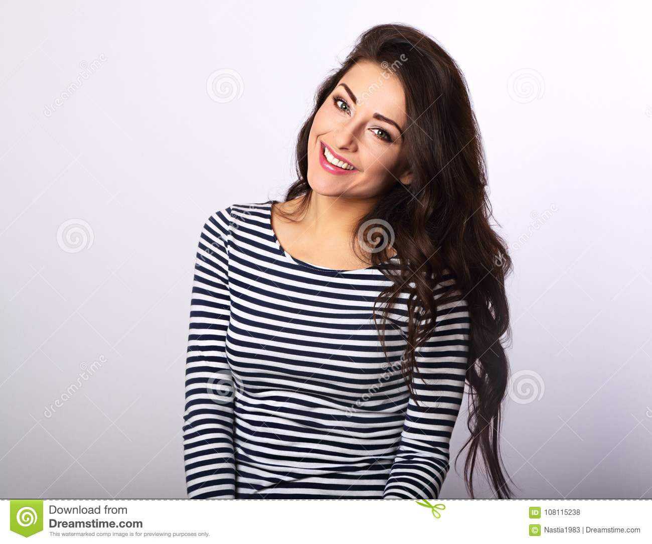 Beautiful positive woman in stripped casual shirt with long hair