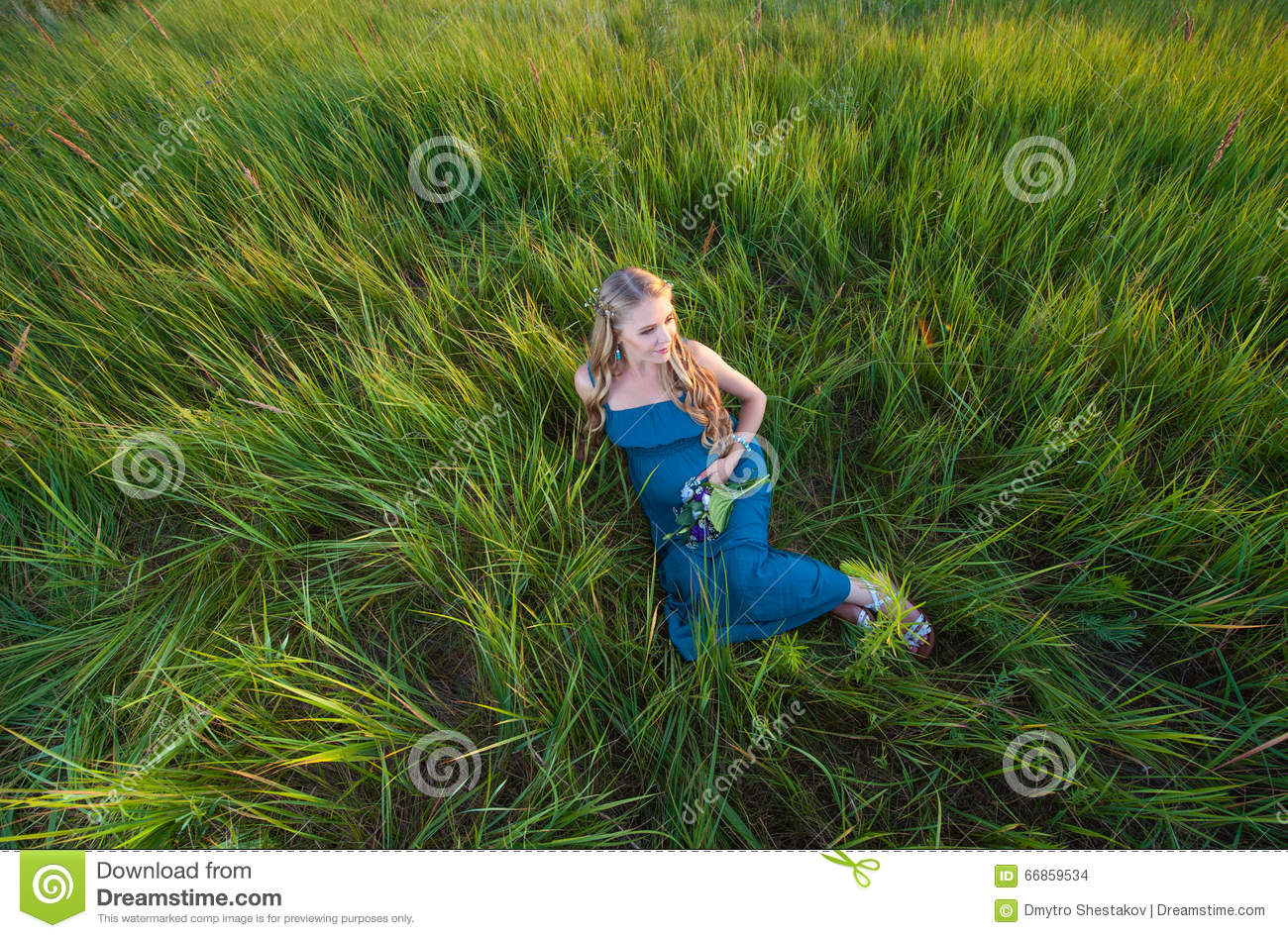 Beautiful pregnant woman lying on green grass stock photo for Pretty grass