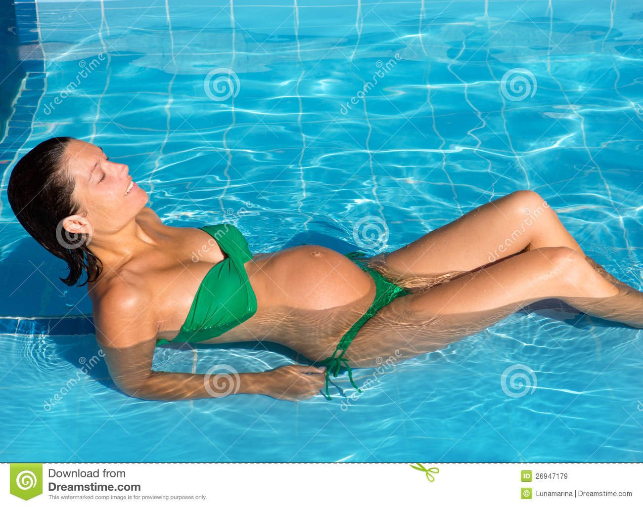68033f5e58f49 Beautiful Pregnant Woman Sun Tanning At Blue Pool Stock Image ...