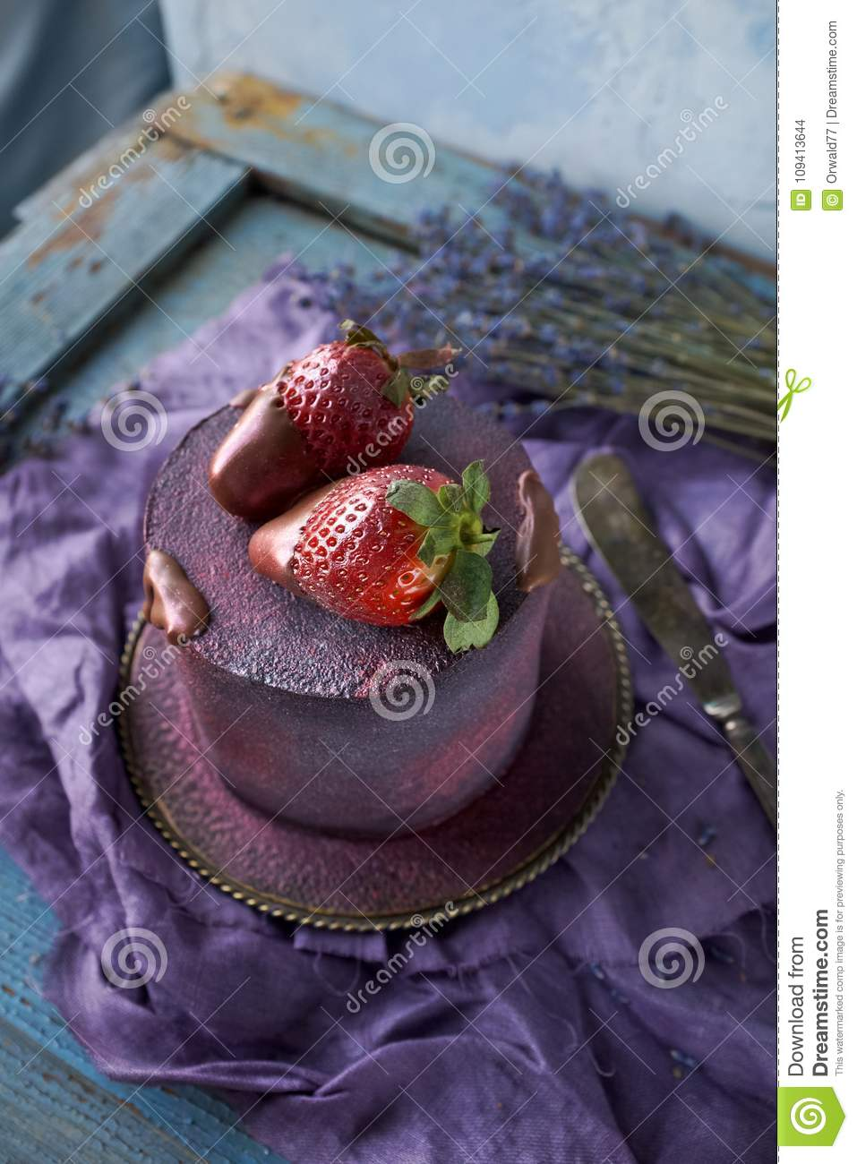 Beautiful Purple Cake Decorated With Chocolate And Strawberries