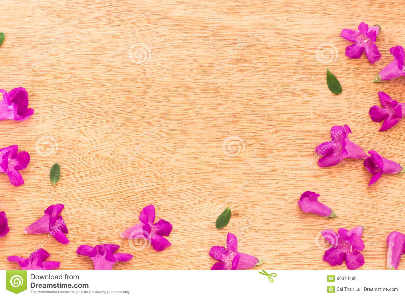 Beautiful Purple Flowers On The Wooden Background Stock Photo