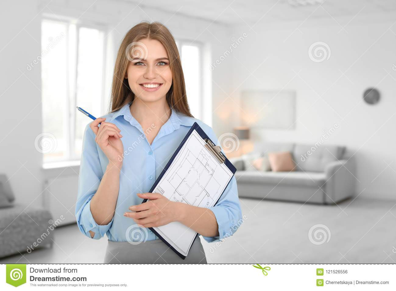Beautiful real estate agent with clipboard