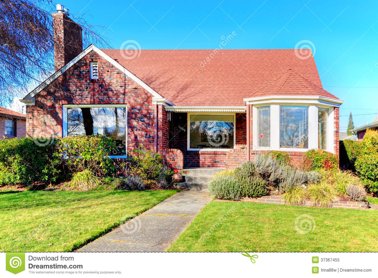 Red entrance door in front of residential house stock photo - Beautiful Red Brick House Royalty Free Stock Photo Image
