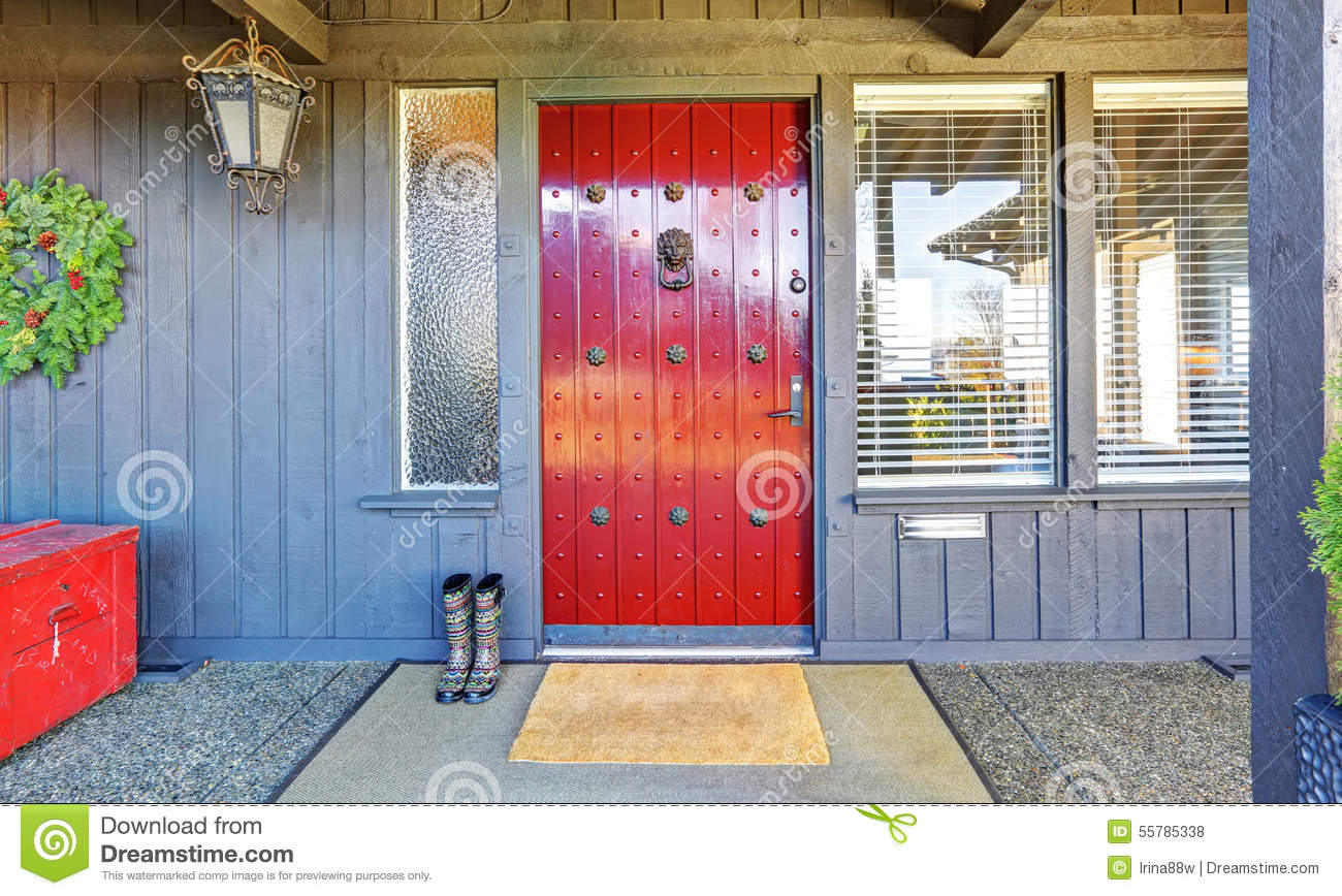 Red Door Grey House beautiful red door and christmas decor with grey wood house. stock