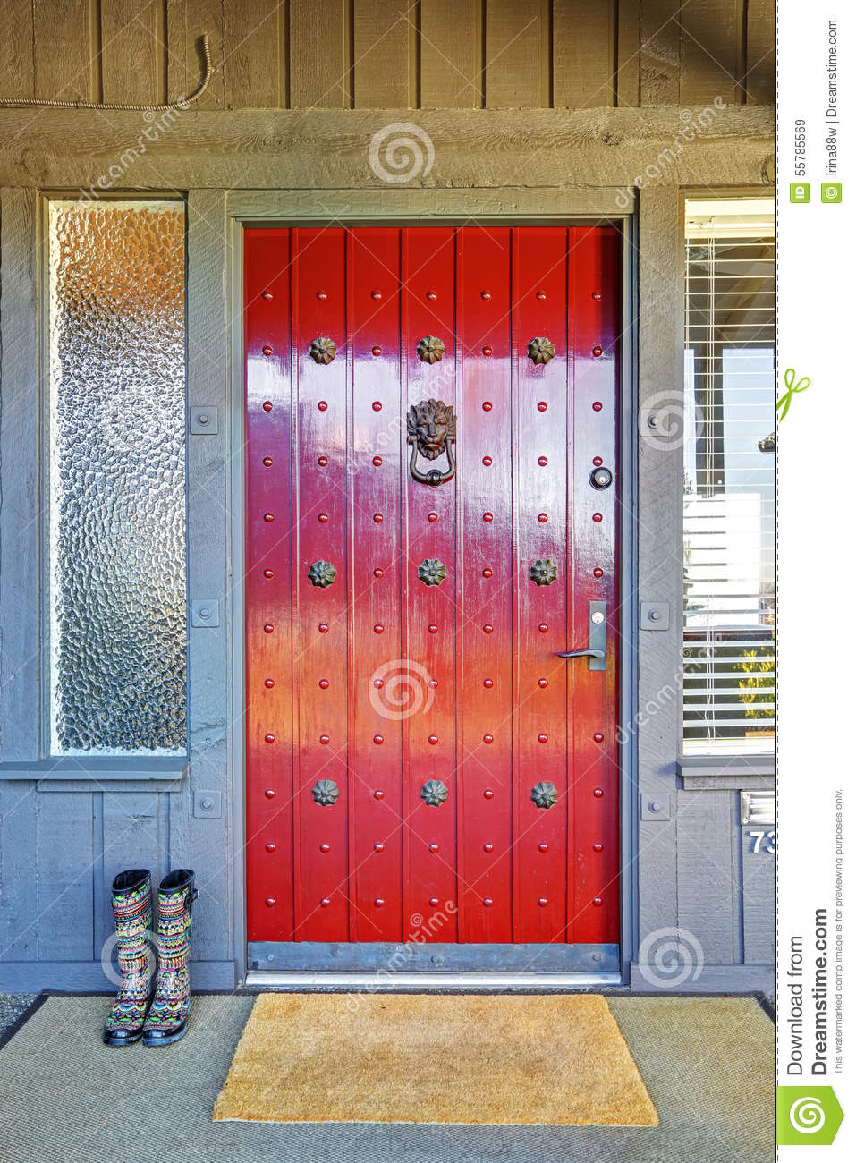 Beautiful Red Door And Christmas Decor With Grey Wood House Stock