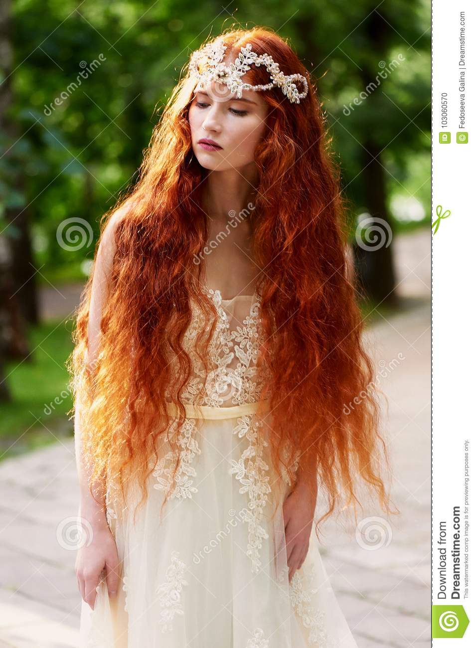 Beautiful Red Haired Girl With Long Curly Hair In The Bride In A