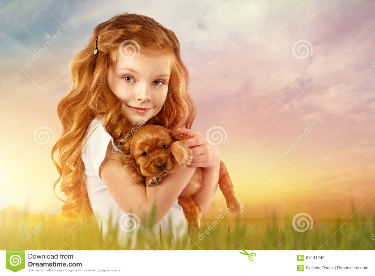 Beautiful red-haired little girl with red puppy outdoor. Kid Pet Friendship