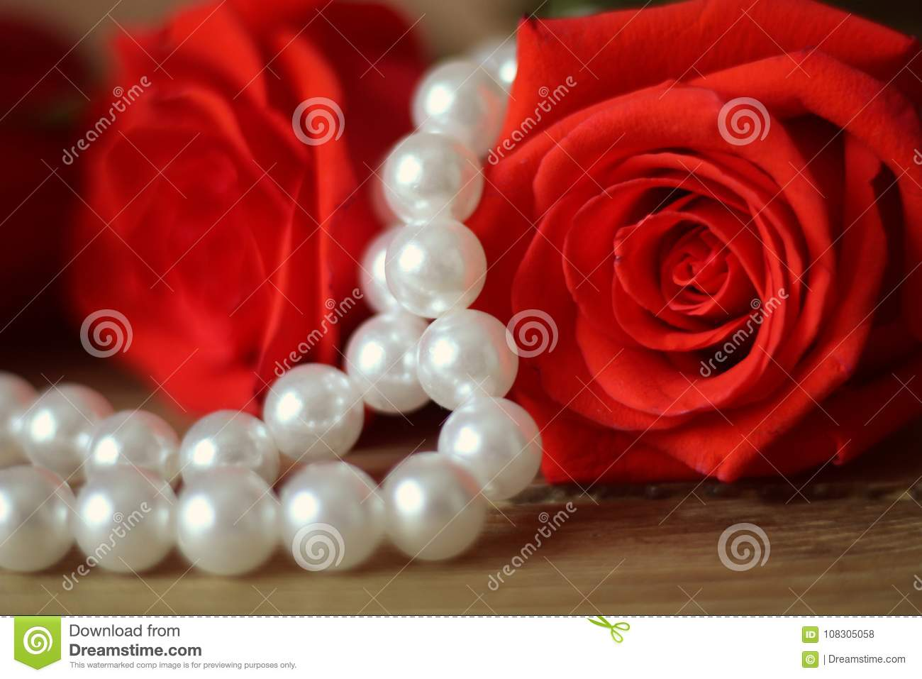 Beautiful Red Roses Lying Ona Woodentable A White Pearl ...