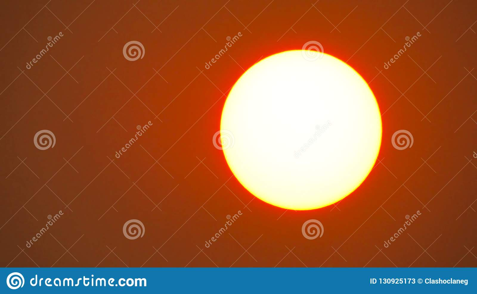 Beautiful red sky behind the sun
