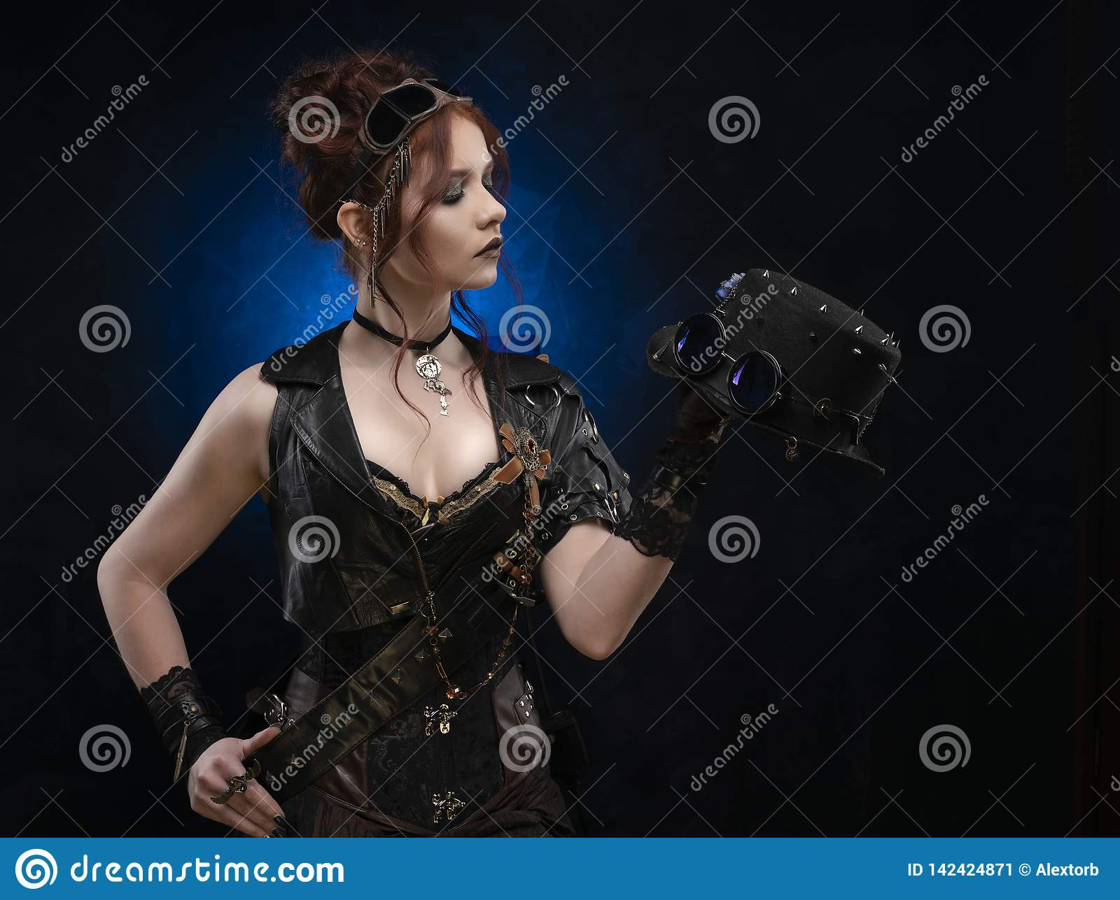 Beautiful redhead cosplayer girl wearing a Victorian-style steampunk corset and leather vest, with large breasts in a deep