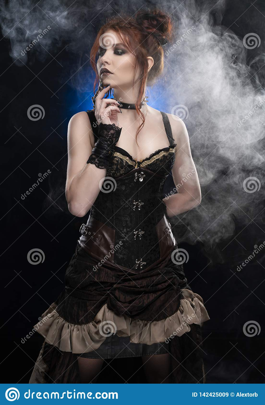 A beautiful redhead cosplayer girl wearing a Victorian-style steampunk costume with a big breast in a deep cleavage standing