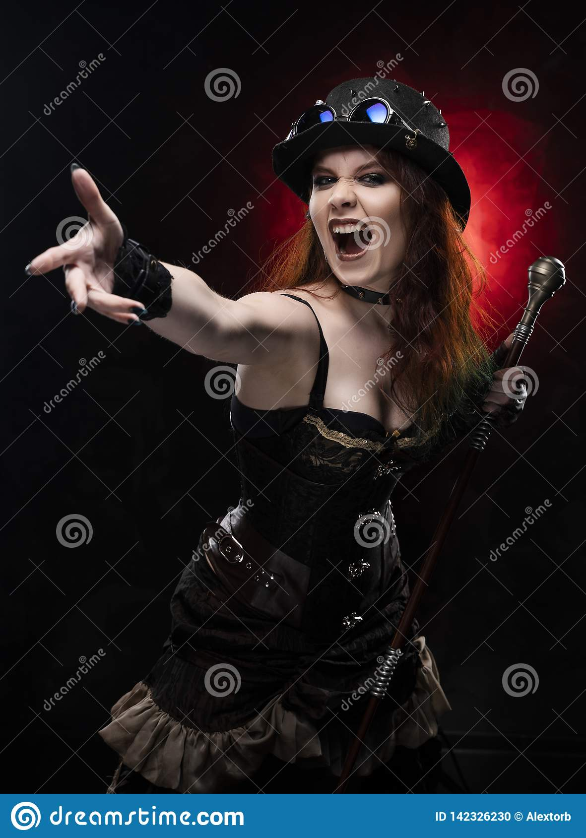 Beautiful redhead cosplayer girl wearing Victorian-style steampunk costume with a big breast in a deep neckline screams and holds