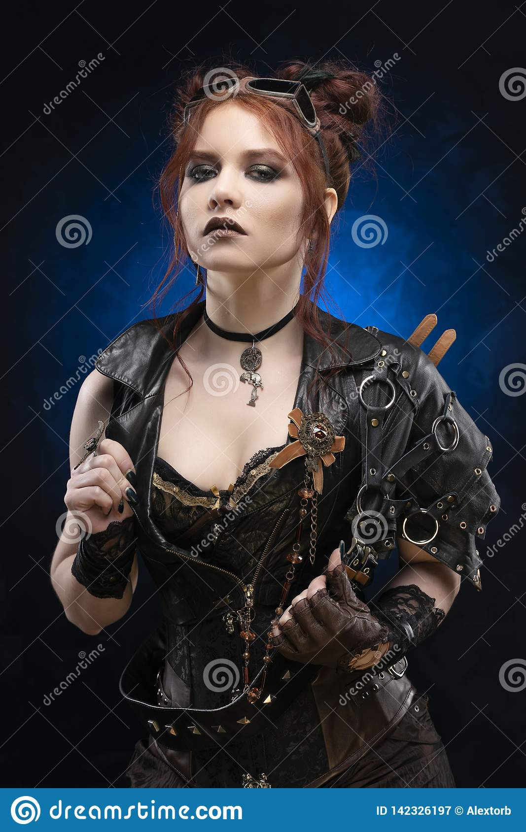 Beautiful redhead cosplayer girl wearing a Victorian-style steampunk costume with big breasts in a deep neckline boldly opens her