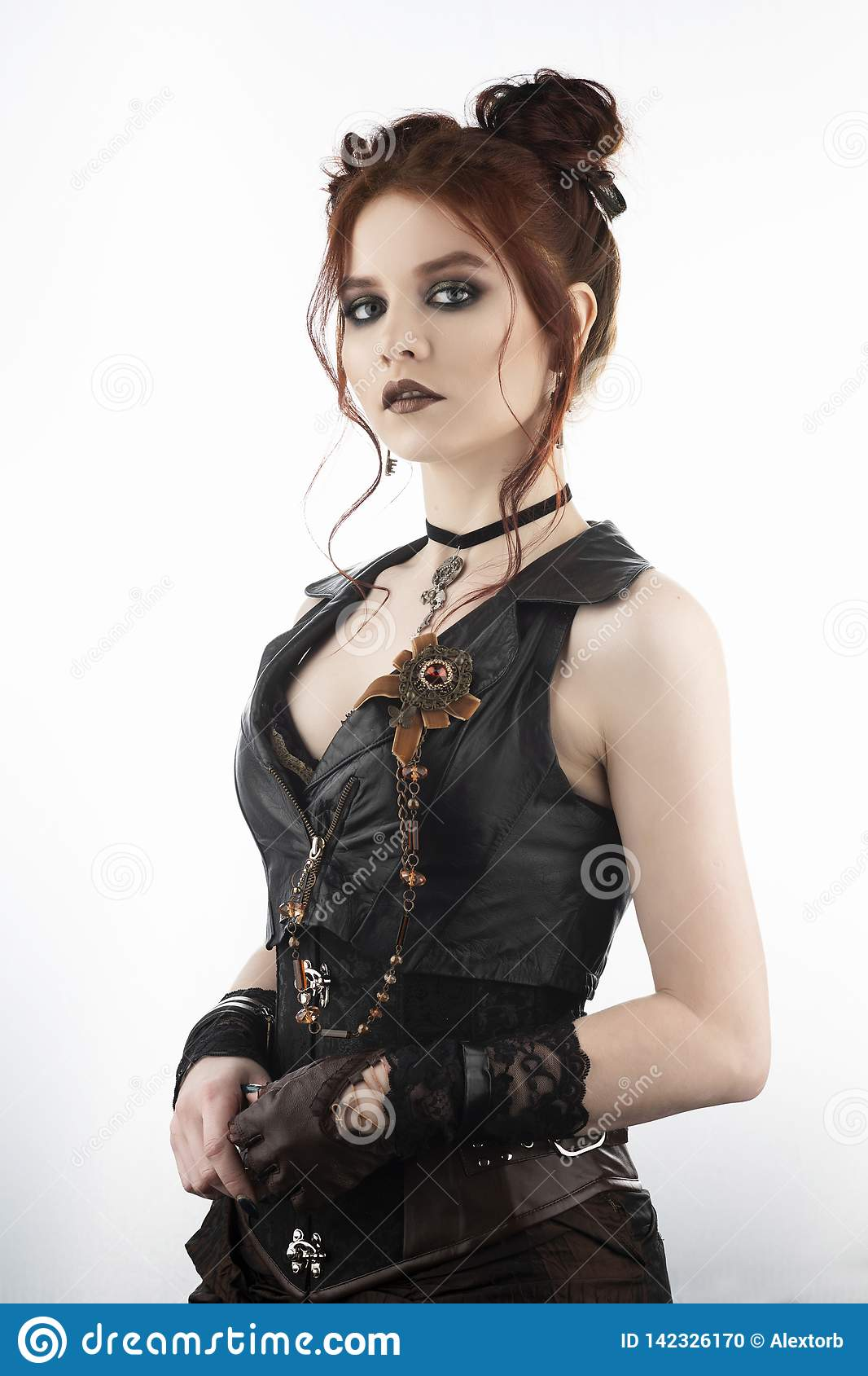 A beautiful redhead cosplayer girl wearing a Victorian-style steampunk costume with big breasts in a deep neckline. Isolated on
