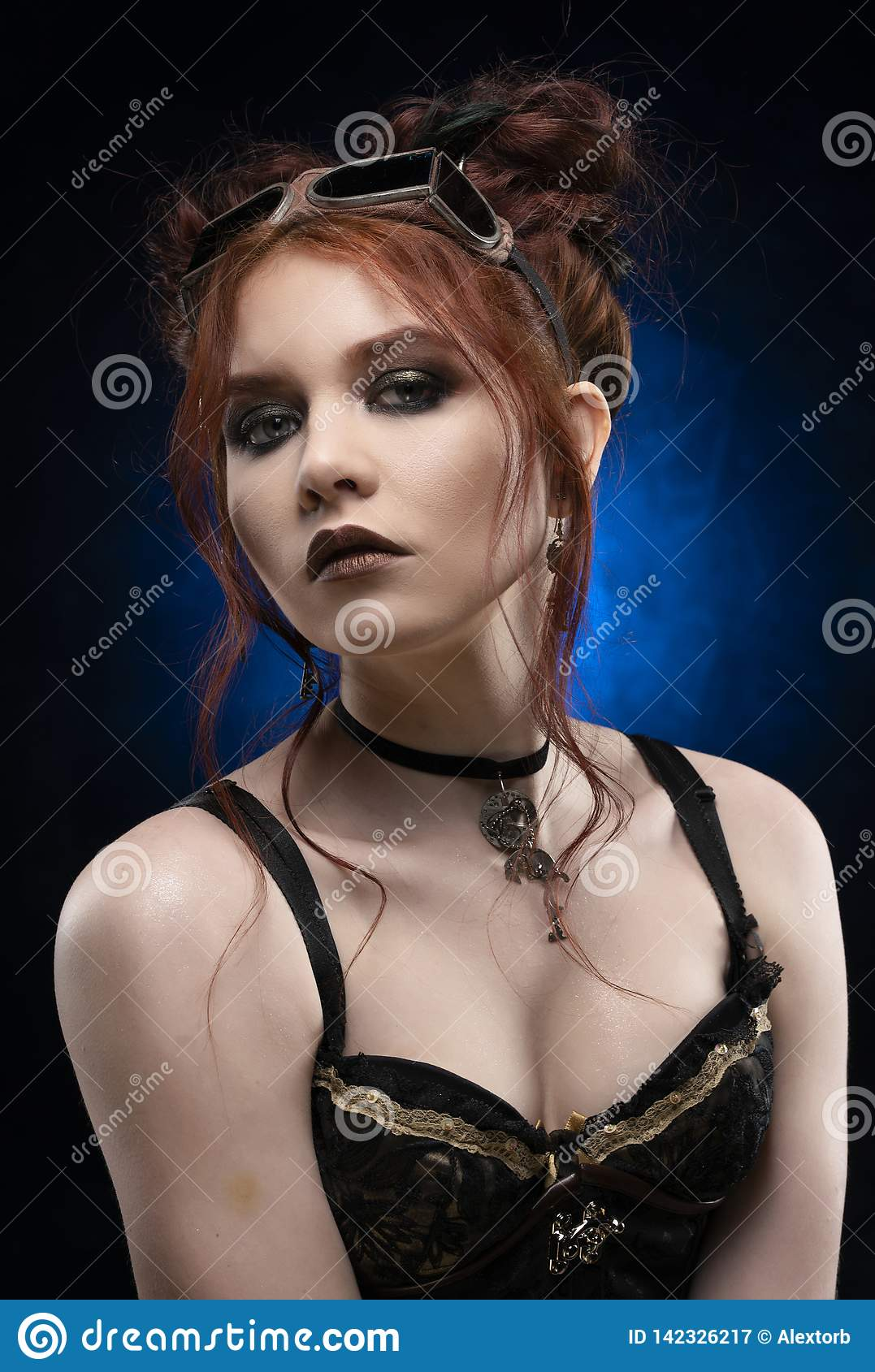 A beautiful redhead cosplayer girl wearing a Victorian-style steampunk costume with big breasts in a deep neckline. Portrait. Blue