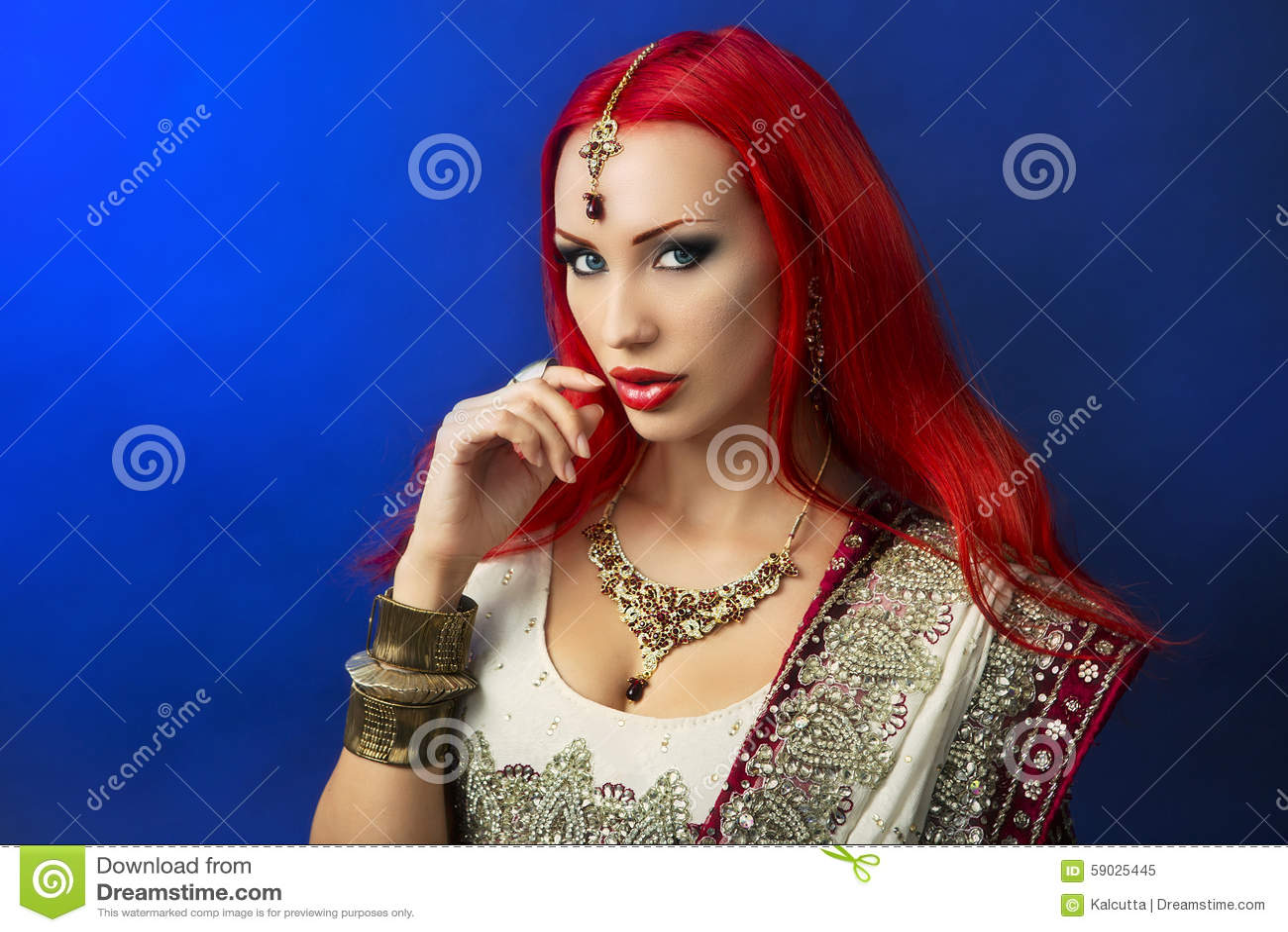 Beautiful Redhead Woman in Traditional Indian Sari Clothing