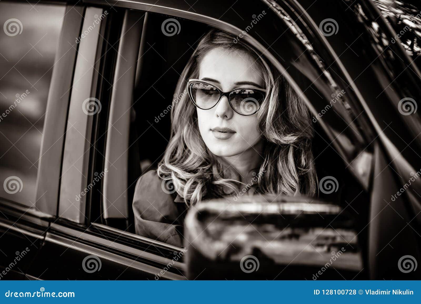 Beautiful redhead woman in the car.