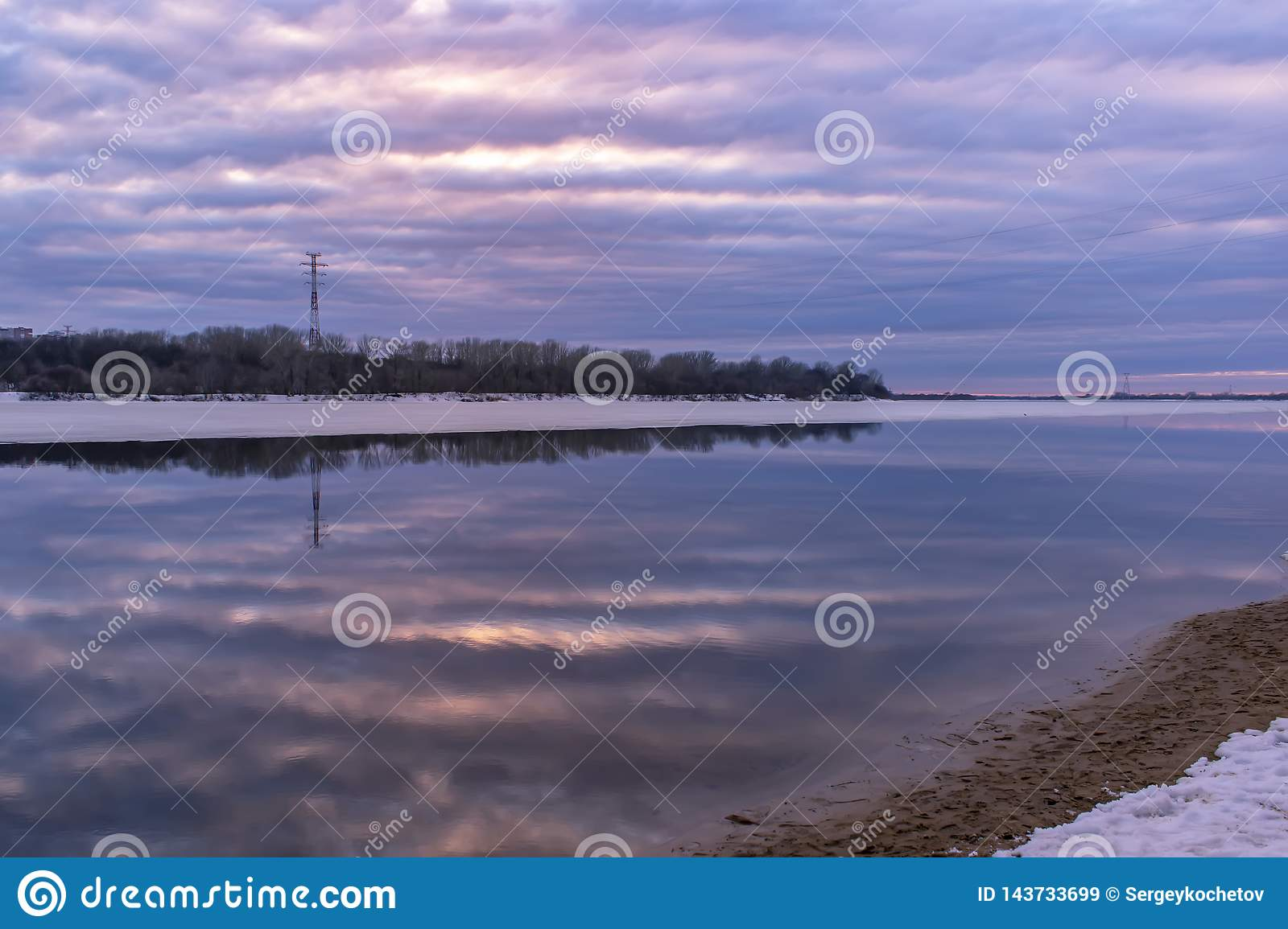 Beautiful reflection of the sky at sunset in the water on the river. Spring background