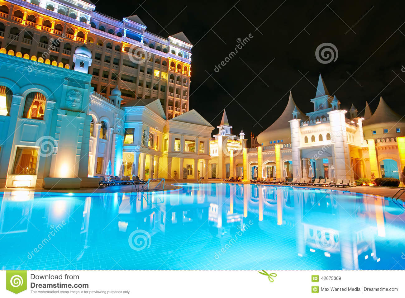 Beautiful resort pool at night stock image image 42675309 for Beautiful hotels