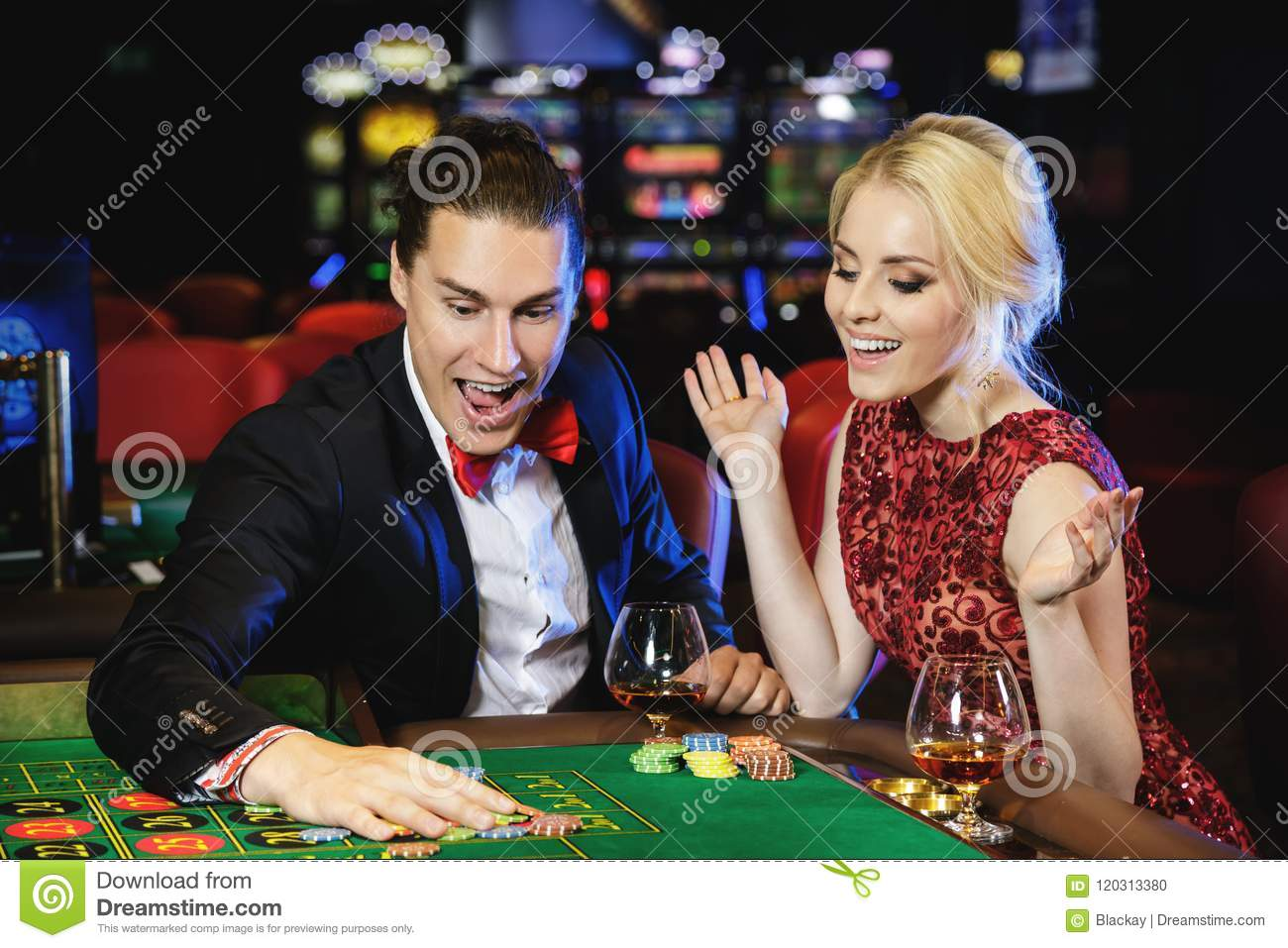 Beautiful and Rich Couple Playing Roulette in the Casino Stock Photo -  Image of casino, money: 120313380
