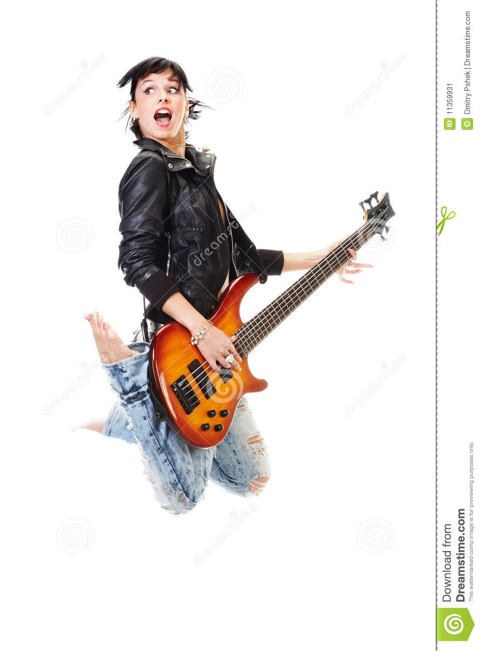 Beautiful rock-n-roll girl jumping with guitar