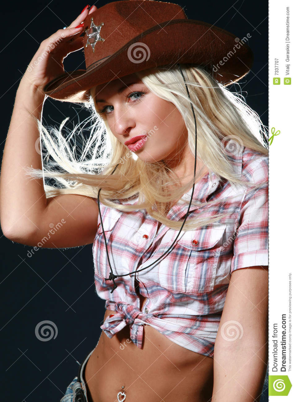 Beautiful rodeo girl wearing a cowboy hat