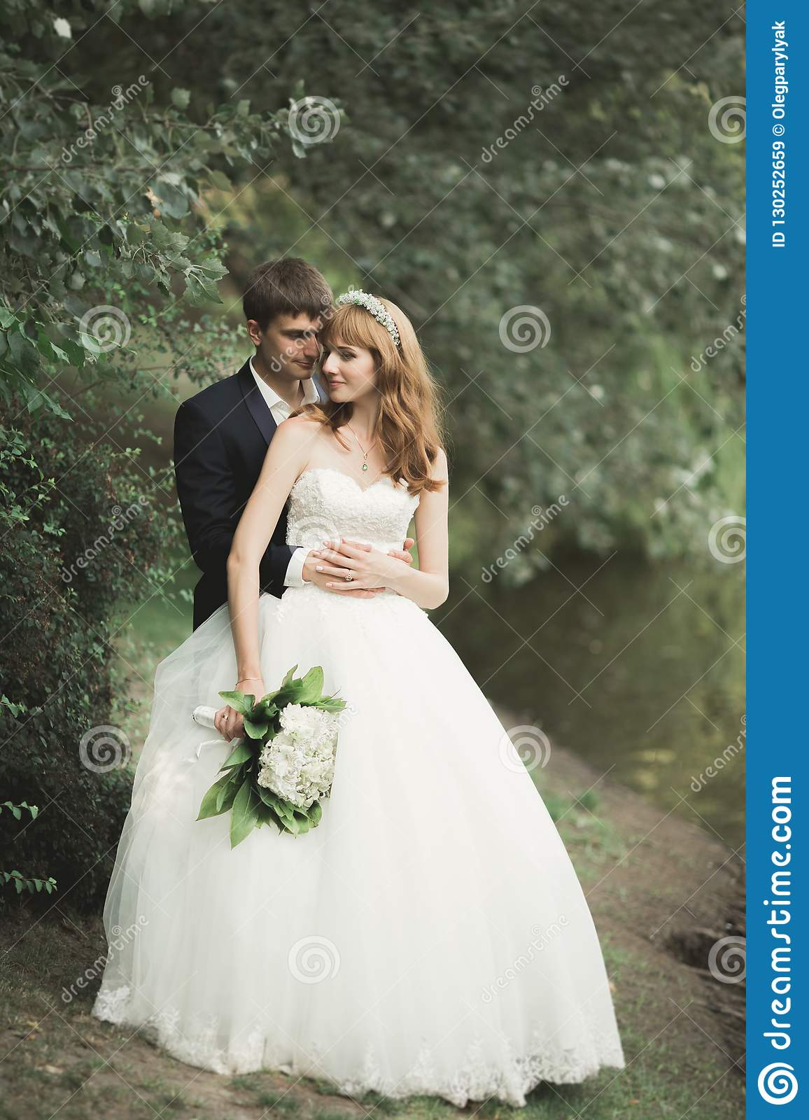 Beautiful Romantic Wedding Couple Of Newlyweds Hugging In Park On Sunset Stock Image Image Of Marriage Couple 130252659